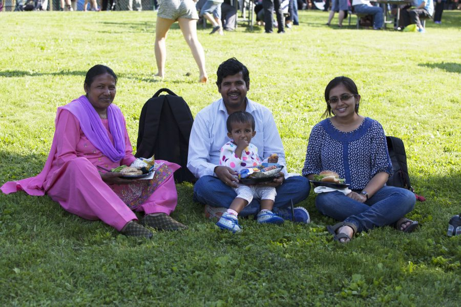 A family at University Apartment's First Responders Picnic.