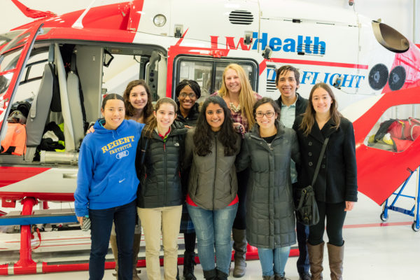 BioHouse residents pose with the Med Flight helicopter after a tour