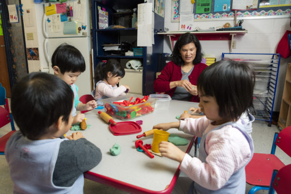 Eagle's Wing students playing with baking toys.