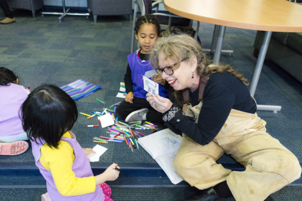 Artist Linda Barry works with Eagle's Wing kids.