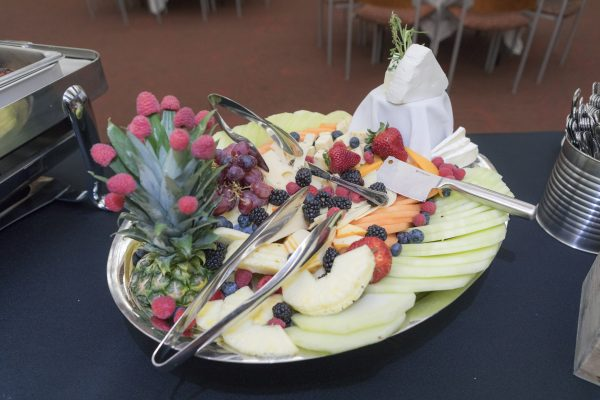 A cheese and fruit plate.