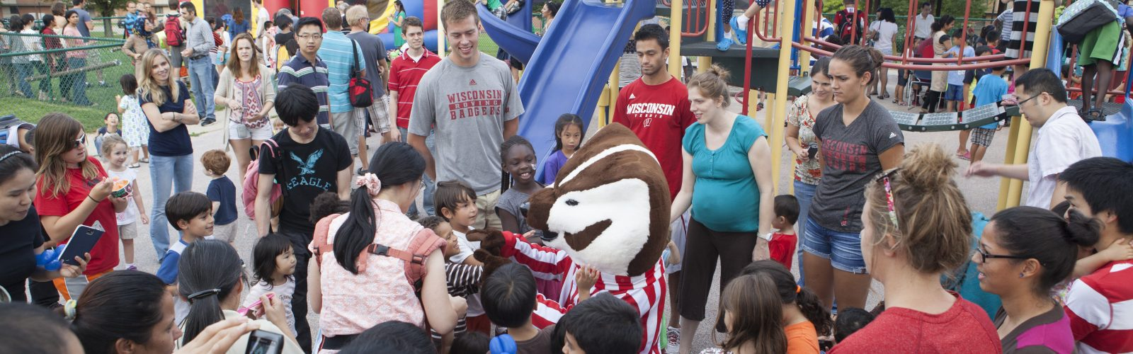 Bucky Badger with families at University Apartments' Ice Cream Social.