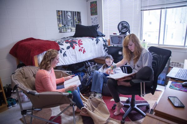 Davis Hall residents studying in their room