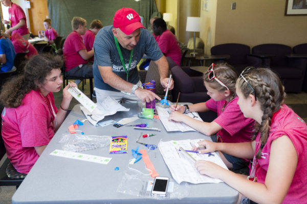 4H rocket science camp counselor works with a group of students