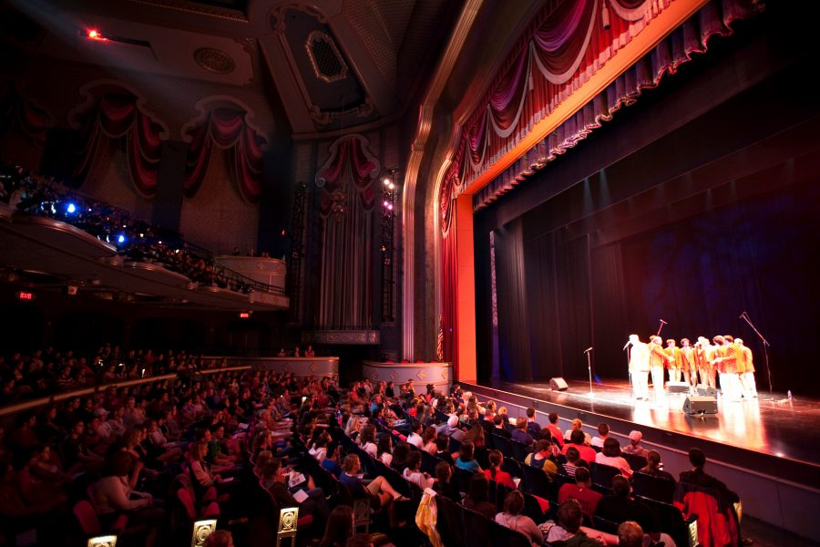 Individuals gather at the Overture Center for a MadHatters performance.