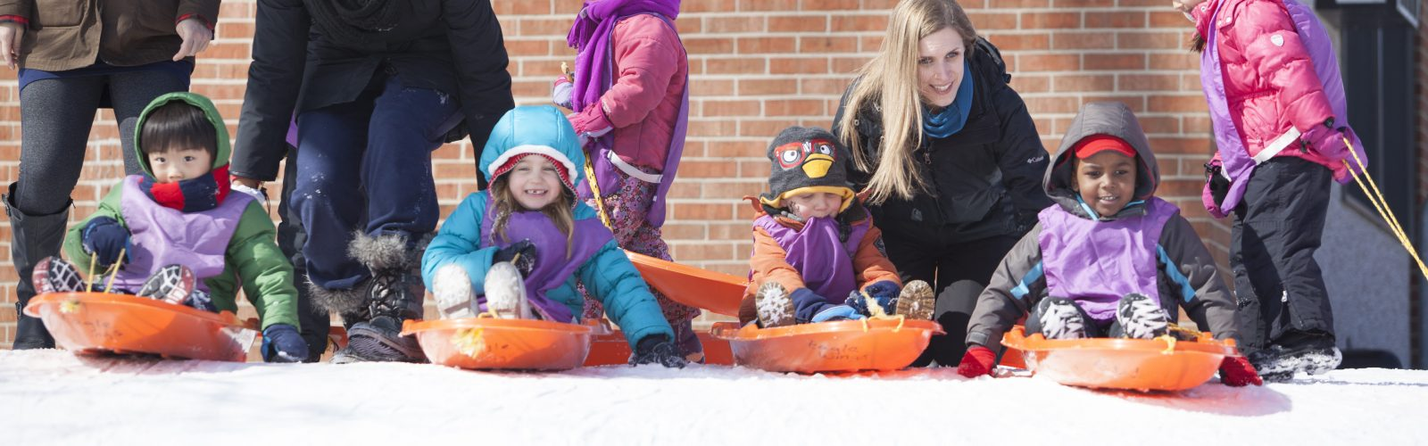 Eagle's Wing students enjoy a day of sledding.