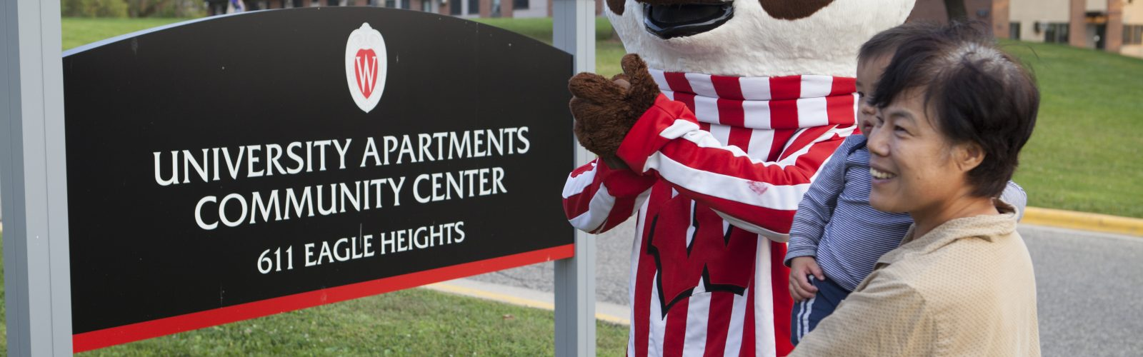Residents pose for photos with Bucky Badger.