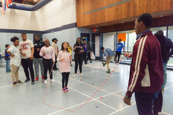 MLC residents jump rope with University Apartments children