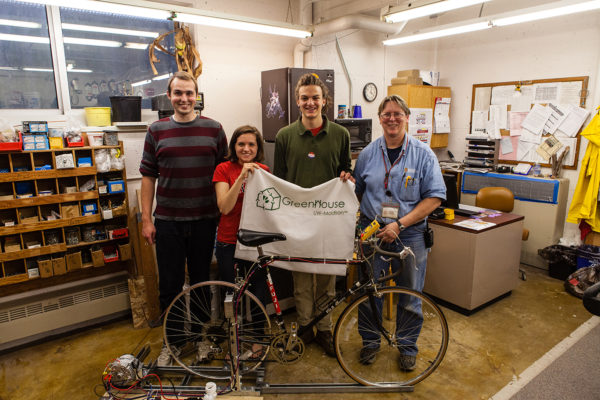 Greenhouse residents pose with bike generator