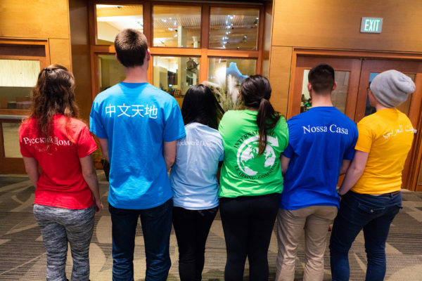 ILC residents show off their diverse t-shirts at their African dinner