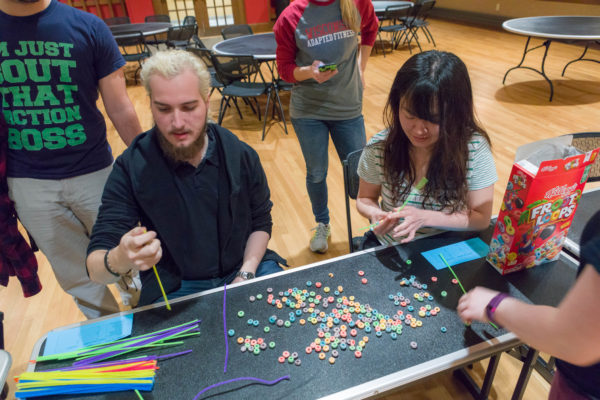 Tripp, Adams, and Slichter Residence Hall residents play games in Carson Gulley Center