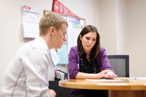 an advisor helps a student at the Wisconsin School of Business