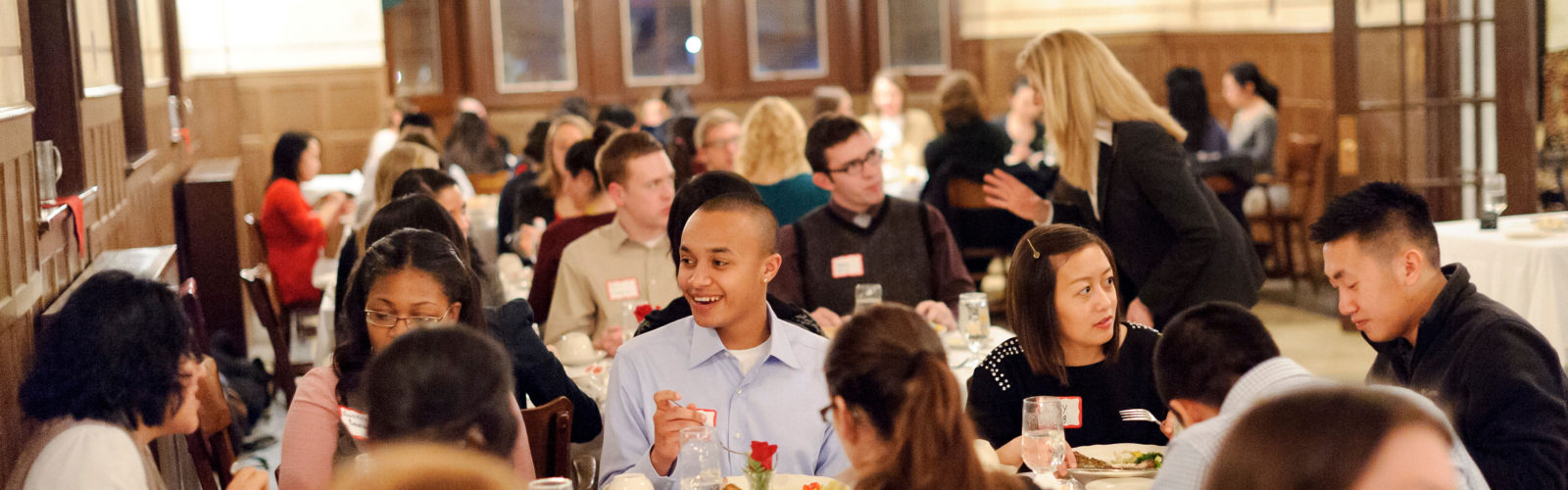students participate in a dinner etiquette training at the Wisconsin School of Business