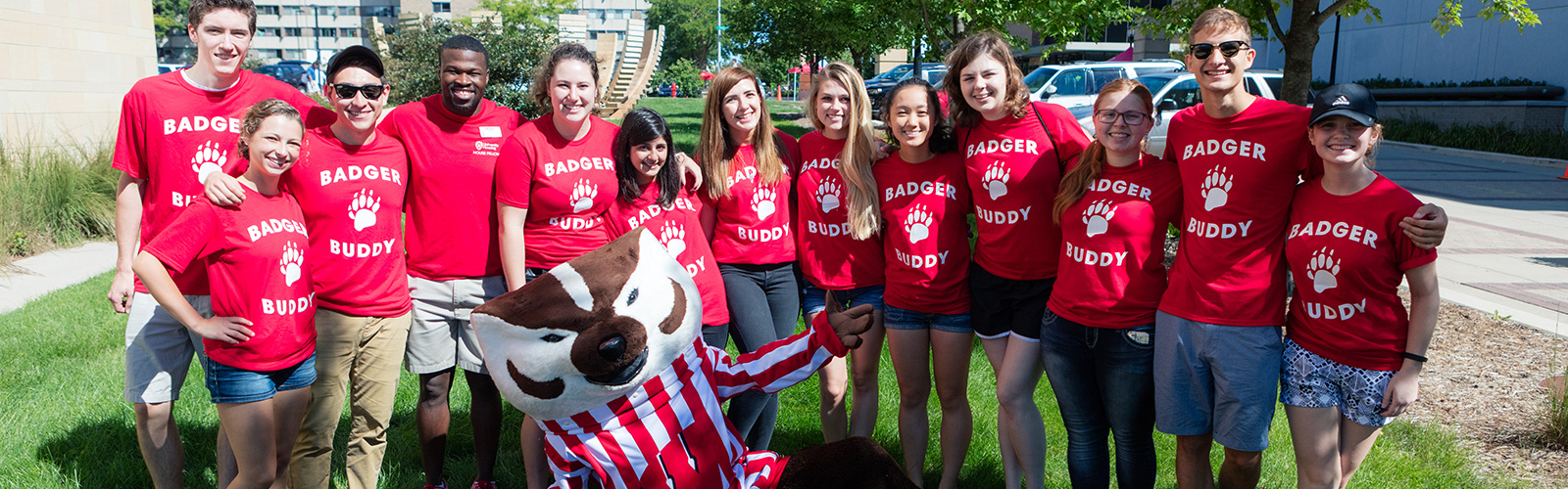 Badger Buddies and Bucky pose outside Ogg Hall before move-in