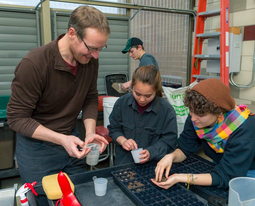Students and staff working together in GreenHouse Learning Community
