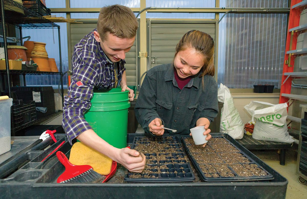 Residents of GreenHouse planting seeds during a seminar