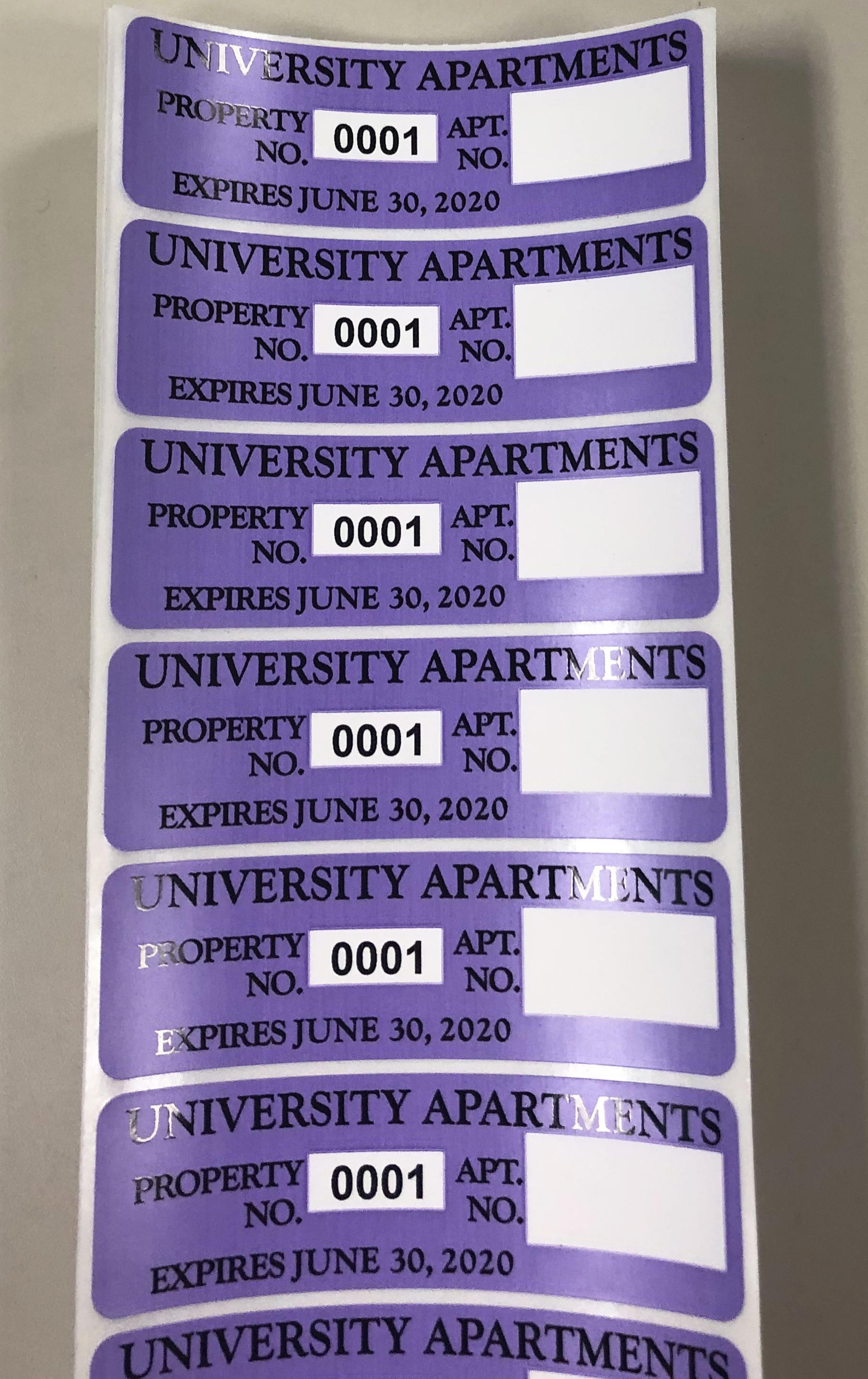 2018-19 dark purple property stickers for University Apartments residents.