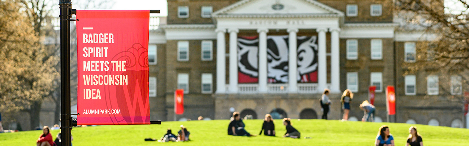 Students enjoy a warm spring day on Bascom Hill