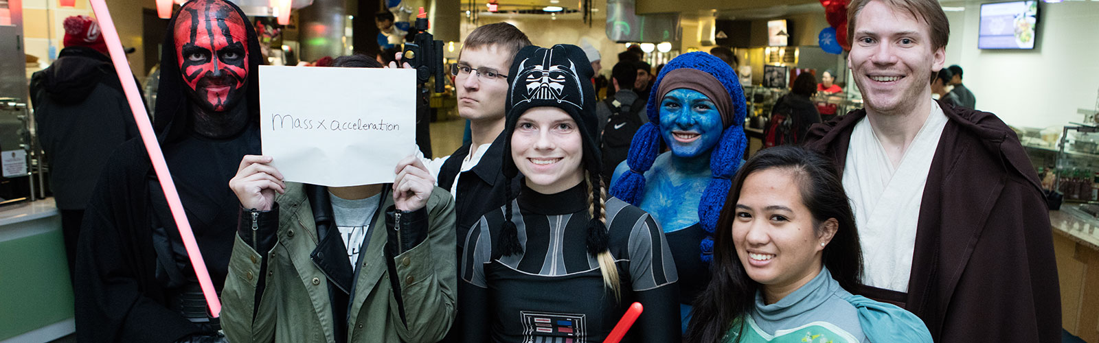 A group of students pose for a photo in Star Wars costumes.