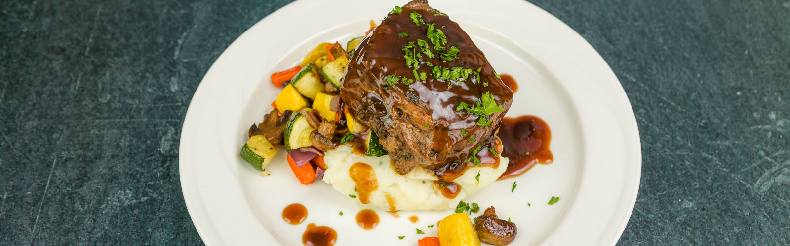 Braised Short Rib, Mashed Potatoes, and root vegetable medley
