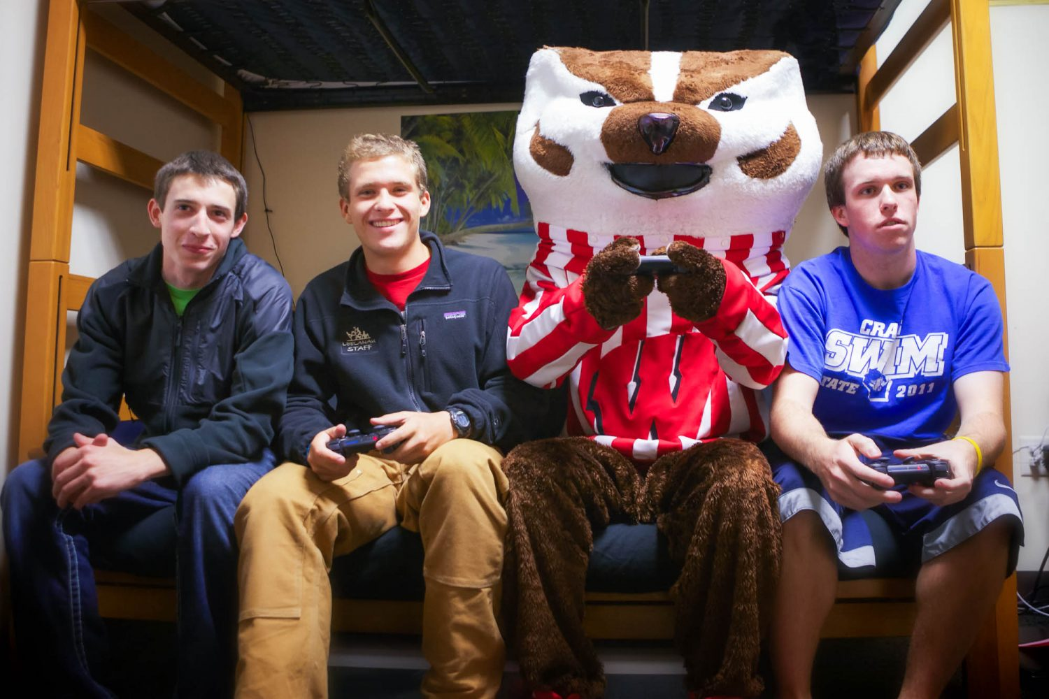 Bucky playing video games with residents