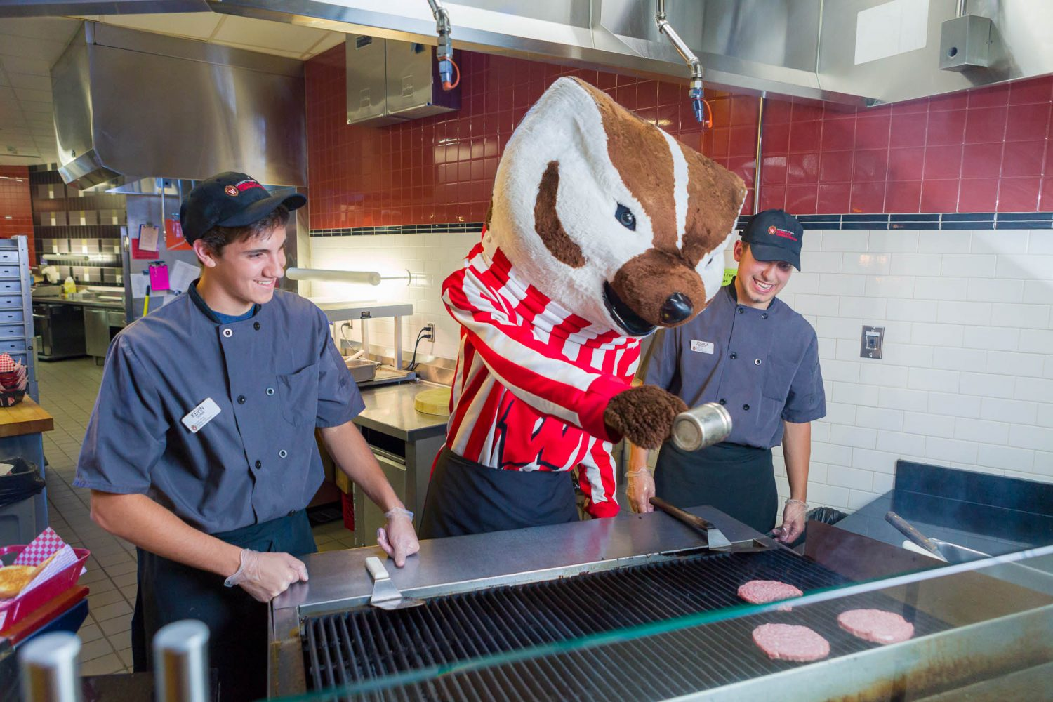 Bucky cooking with Dining staff