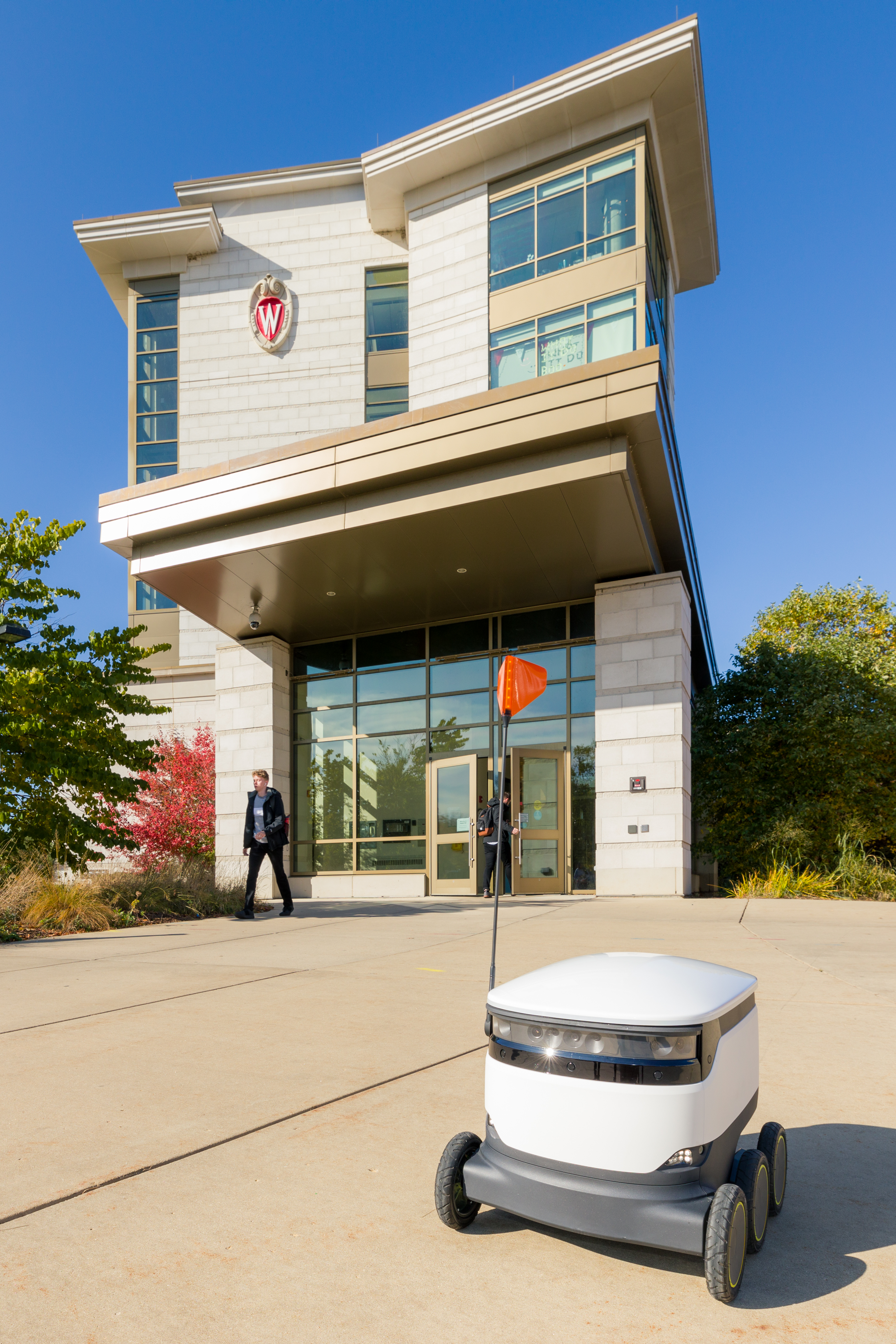 A Starship Delivery robot stand ready to deliver food outside Dejope Residence Hall.