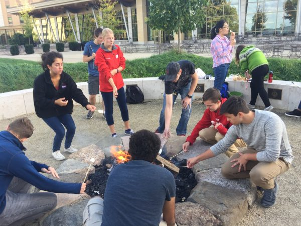 Residents making s'mores at the Dejope fire circle