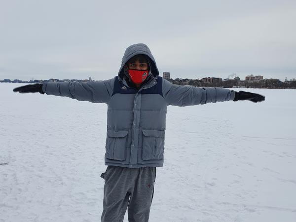 BLC resident poses against the Madison skyline