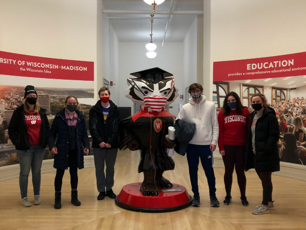 BLC residents pose with a Bucky Badger statue
