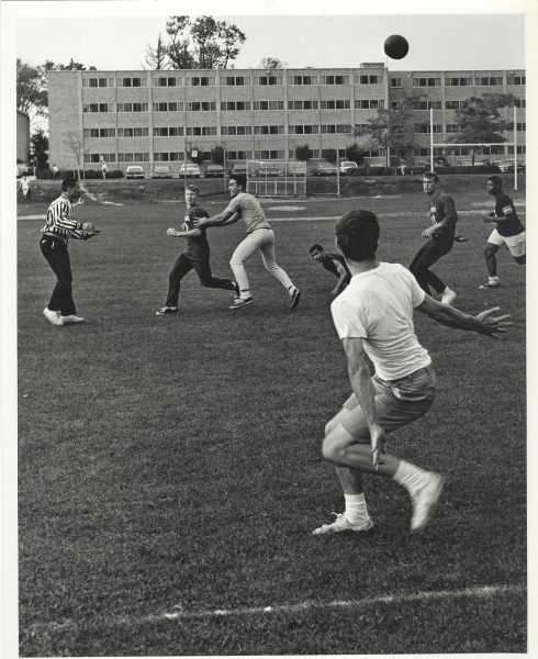 Students playing a game outside Bradley Hall