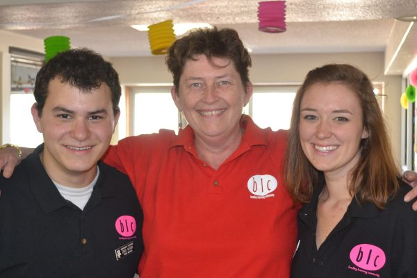 Peer Mentors Zack and Mari with Faculty Director Susan Brantly
